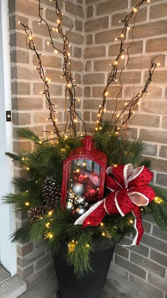 Pot de sapinage avec lumières de Noël